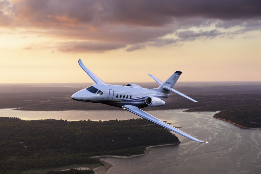 Aerial photography of the Textron Cessna Latitude business jet flying over Keystone Lake, west of Tulsa, OK.