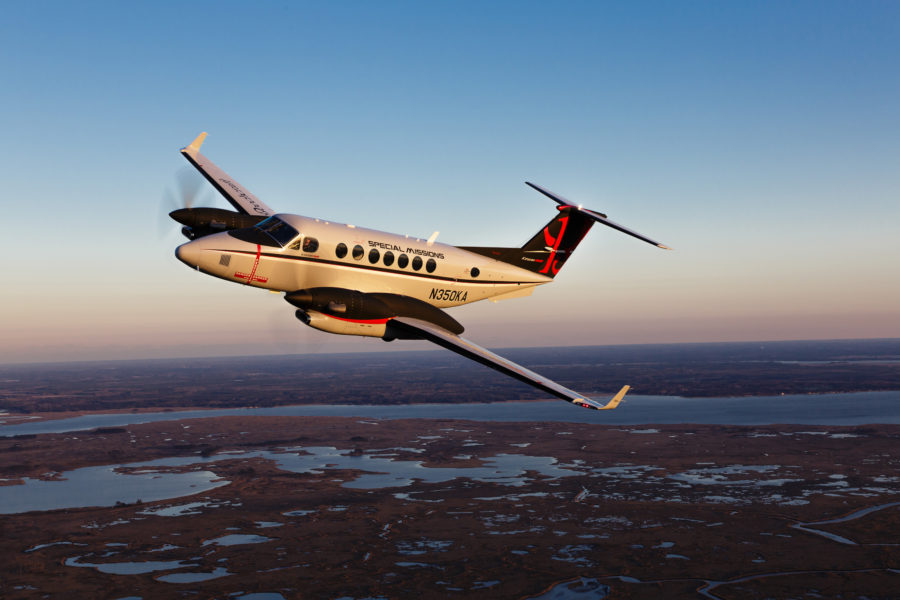 Aerial photography of the Textron Beechcraft Special Missions King Air 350ER over the Blackwater National Wildlife Reserve. The 350ER is equipped with engine nacelle fuel tanks that extends its range and a gravel kit for unimproved field operations.